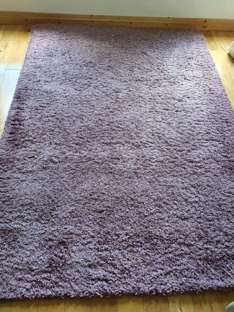 purple rug before cleaning